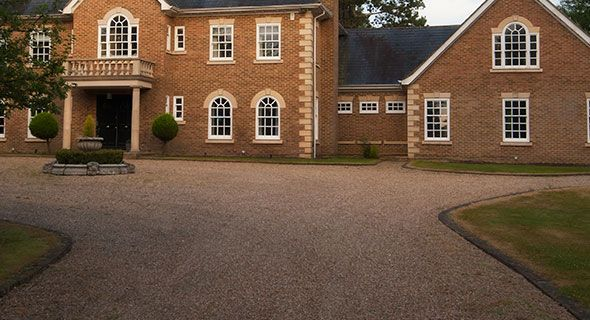 mansion with gravel driveway